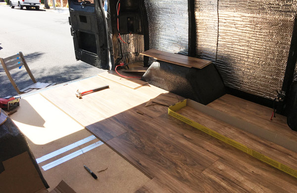 Installing the laminate planks in Jean Claude Van Ram.